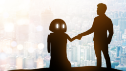 Manufacturing Trends: Shadow of a robot and man looking over a city