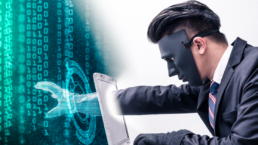 The abstract image of the hacker reach hand through a laptop screen for stealing the data as binary code. the concept of cyber attack, virus, malware, illegally and cybersecurity.