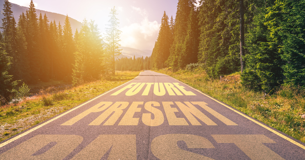 Past, Present, Future concept. Driving on an empty road in the mountains to the Future passing Present and leaving behind the Past.